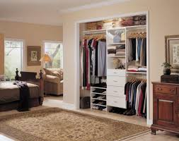 ikea closet organizers in bedroom with shoe storage plus persian rug