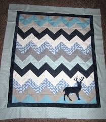 Sewin Sanity: February 2014 & I chose to do a deer applique on the quilt and am so happy I did. It looks  like mountains! The deer and navy boarder are in minkee like the sheet and  ... Adamdwight.com