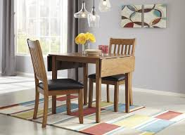 signature design by ashley joveen 3 piece drop leaf dining table and upholstered chair set wayside furniture dining 3 piece set