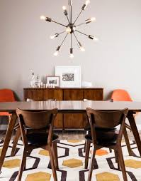 love the rug in this mid century modern dining room