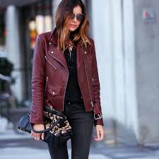 burdy leather jacket with lace up top and leopard print bag