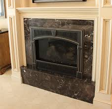 this portland street of dreams fireplace is tiled in new lau marble