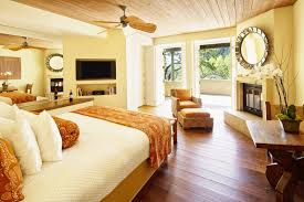 bedroom decor ceiling fan. This Light And Airy Master Bedroom Features Rich Hardwood Flooring, A Corner Fireplace An Decor Ceiling Fan O