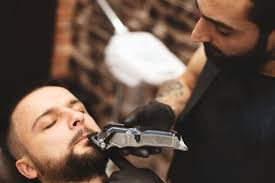 premium photo shaving a beard in a