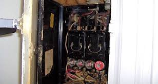 why is an old fuse panel dangerous when the wiring in a house is overloaded too many appliances drawing current it overheats and can start a fire in the walls or attic