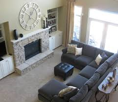 Black Leather Ottoman Coffee Table With Gray Microfiber Sectional Sofa And Side  Table On Beige Area Rugs Plus Beige Jcpenney Curtains Also Stone Fireplace
