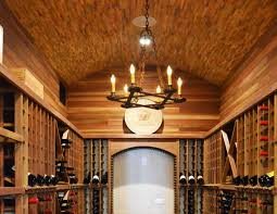 an all wood wine cellar with a barrel vaulted ceiling an iron chandelier in barrel wine cellar designs