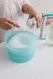 mixing cleaning solution with blue bucket