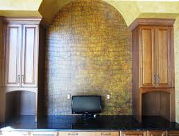 This den is a great place for two rich finishes such a this crocodile faux  used as an accent above the desk and the faux leather around the rest of  the room ...