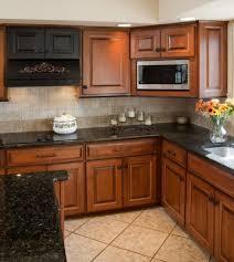 photo dark brown cabinets dark countertops