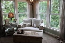 comfortable white oversized chair with ottoman for reading and relax in the corner with chandelier and