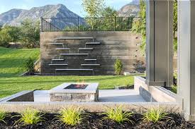 a creative alternative to standard water walls perfect to make an outdoor space look more