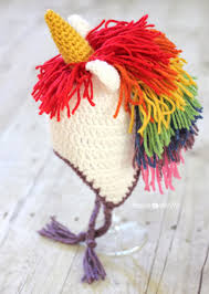 do you have a little girl that loves unicorns if so she is sure to love this crochet unicorn hat with a rainbow mane perfect for dress up