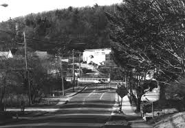 the large building in the background is wolfers lighting on bear hill road across the rt 128 bridge