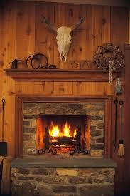 wood trim enhances the beauty of gas fireplaces