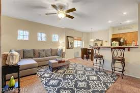 this stunning home features an open floor plan concept with kitchen dining living room lots of natural light recessed lighting ceiling fan and outdoor