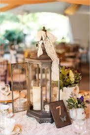 wedding table decorations ideas. Rustic Wedding Decor Ideas-flowers In Lantern Centerpiece. Vintage And Shabby Table Number Decorations Ideas