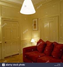 Yellow And Red Living Room A Traditional Yellow Living Room With Wood Panelled Walls Red
