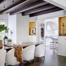Fresh, White Dining Room With Exposed Beam Ceiling