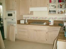 kitchens with white appliances and oak cabinets. Before Painting Refinishing Oak Kitchen Cabinet With Glass Door And Brown  Marble Countertop Plus White Appliances Ideas Kitchens With White Appliances And Oak Cabinets