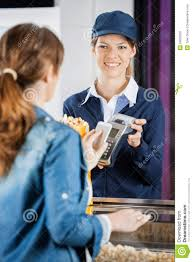 concession worker accepting payment from w stock photo image concession worker accepting payment from w