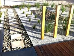 full image for pathway from house to vegie garden steel edging on side with large pebbles
