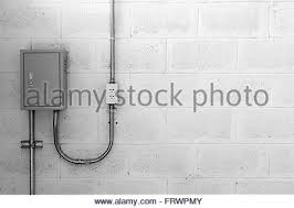 energy electric plug on a concrete wall stock photo royalty white power outlet electric box on concrete wall steel tube and plug black and white stock