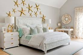 contemporary beach cottage bedroom with gold starfish wall decor