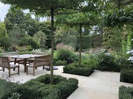 Formal And Informal Landscape Design Stunning Roof Trained Liquidamber Trees Were Placed Near The