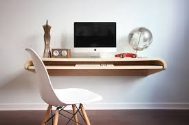 The first one is a minimalist floating Wall Desk designed by Dario  Antonioni that mounts easily to any wall type (wood studs, sheet metal  studs, concrete, ...
