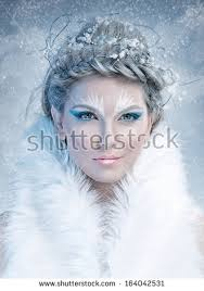ice queen beautiful woman in winter professional makeup with white fur