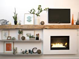 a p out fireplace is made to look built in with the addition of