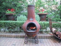large chiminea outdoor fireplace chimine plce exples reltive nd drwbcks large clay chiminea outdoor fireplace