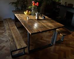 industrial chic dining table made with reclaimed wood and raw steel