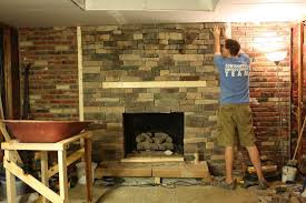 the stone veneer that i ve been talking about putting up for the last couple of posts is mostly finished now we put the last piece for the wall up last
