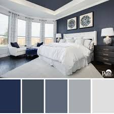 This bedroom design has the right idea. The rich blue color palette and  decor create a dreamy space that begs you to kick back and relax.