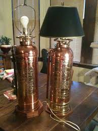 antique ny and chicago fire extinguisher lamps