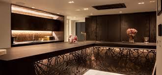 lighting a beautiful dark wood kitchen