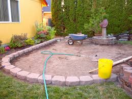 patio with retaining wall new wow thats a busy garden creating a paver and pebble mosaic