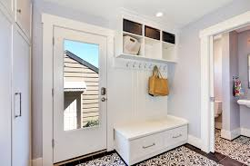 Tiled mudroom in a sleek and modern design. White as the dominant color in  this one makes it look fresh and tidy.