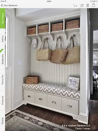 Built in bench with large drawers, bead board wall, large hooks, cubbies  above