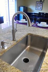 a simple diy tutorial on how to install a kitchen faucet whether you are going
