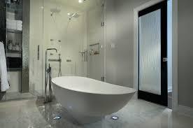 view in gallery modern bathrooom with a rain glass door