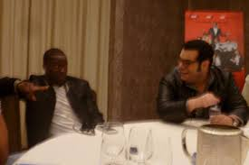 co stars josh gad and kevin hart discussing the wedding ringer at a round table