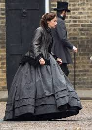 downpour felicity jones was doing her best to stay dry on thursday as the