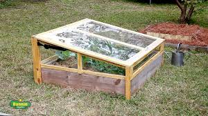 protect your plants from frost and cold weather by building a simple raised bed cold frame