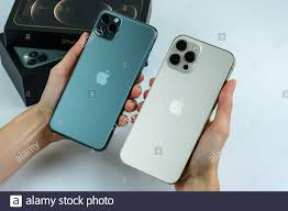 Phone 12 Pro Max in Gold next to iPhone 11 Pro Max in Midnight Green color  Stock Photo - Alamy