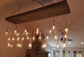 a smaller version of ligon s largest work an 80 bottle chandelier for a restaurant