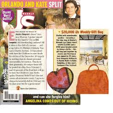keira knightley with julie kenney signing the tsunami gift bag that was auctioned off on
