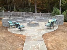 patio with firepit and built in seating featuring rssy pennsylvania irregular flagstones or stand ups